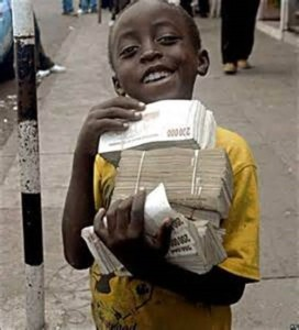 Happy boy with Zimbabwe money